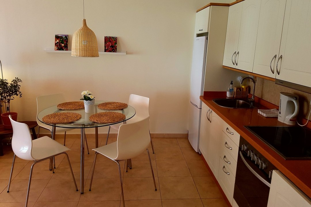 Paraiso 2 - 1 Bed Apartment - Heated Swimming Pool - Dining + Kitchen area